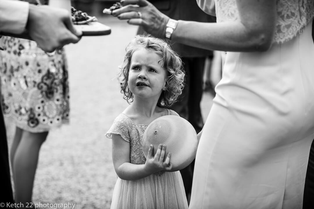 Flower girl looking bemused at Whitney Court wedding