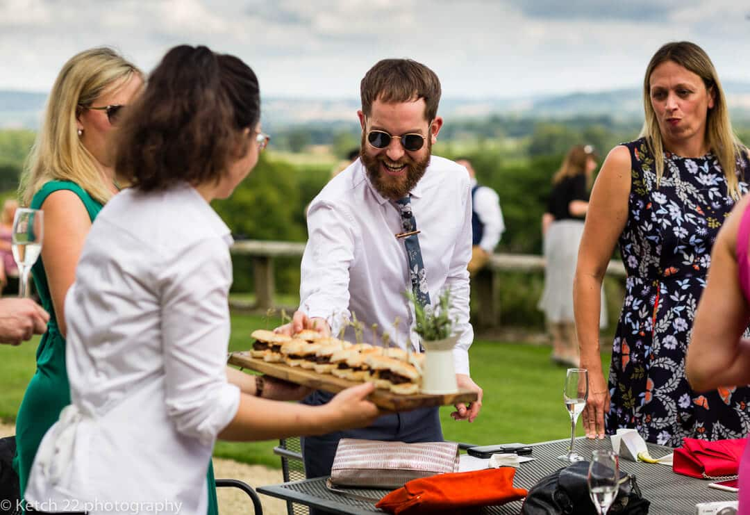 Wedding guest enjoying canapes at Whitney Court