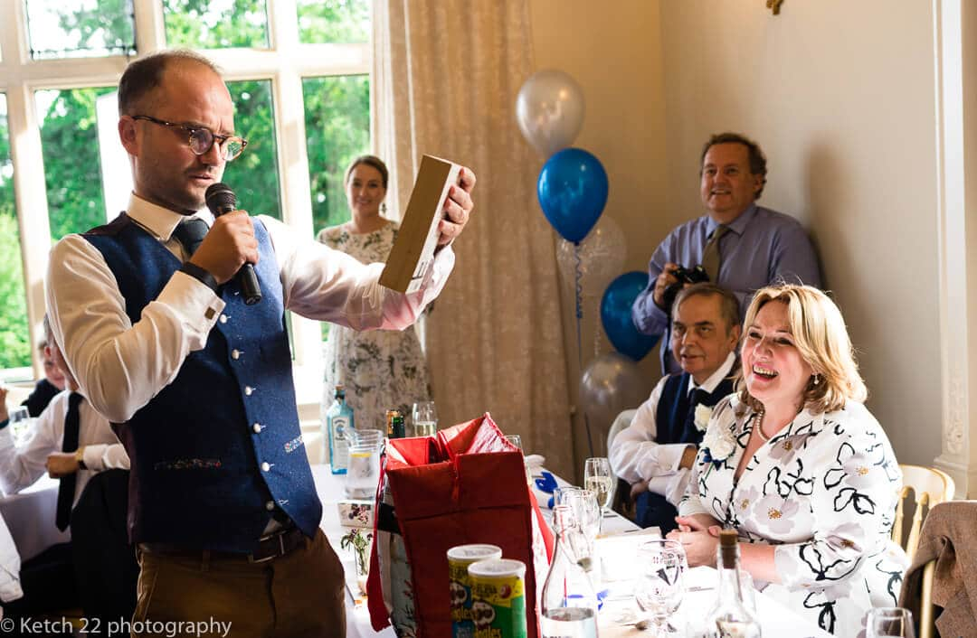Best man making speech at reportage wedding