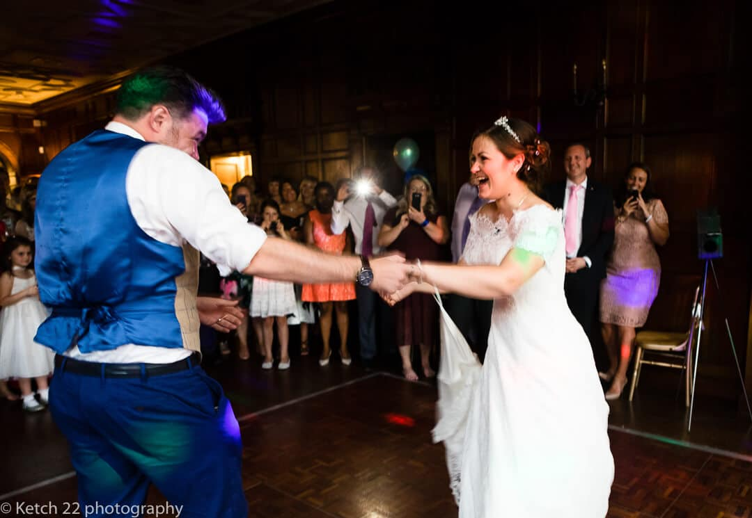 Bride laughing at first dance at wedding reception