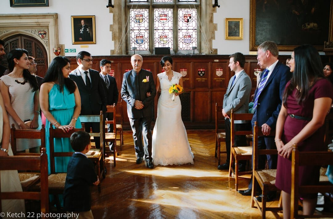 Father of bride and daughter walking down aisle at civil wedding ceremoy