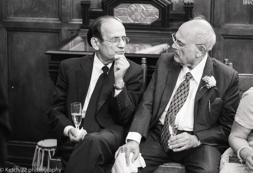 Two Granddad's chatting at wedding reception