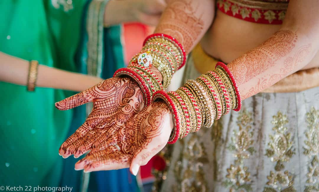 Beautiful henna painted hands of Indian bride