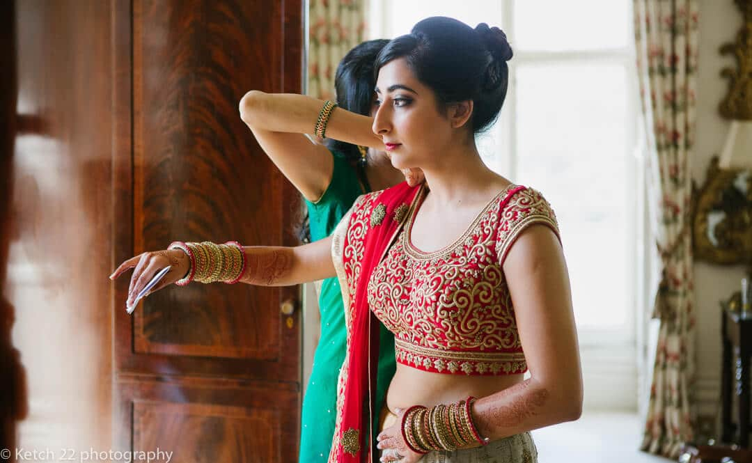 Hindu bride puts on colourful wedding dress at Highclere castle