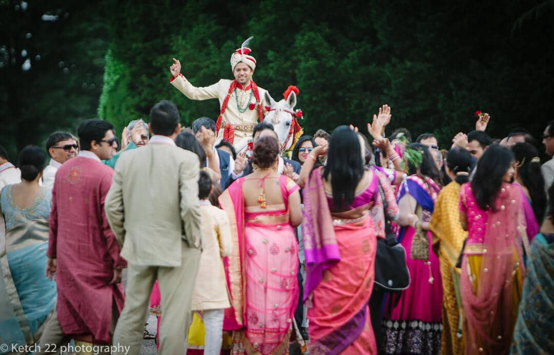 Hindu groom on horse back at Highclere castle