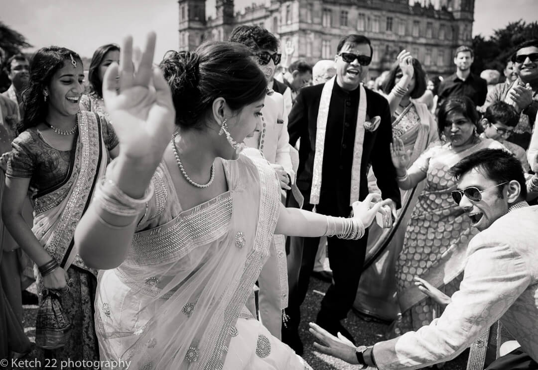 Black and white photo of Indian wedding guests dancing