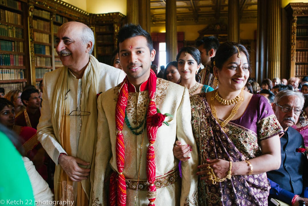 Groom and parents enter Hindu ceremony