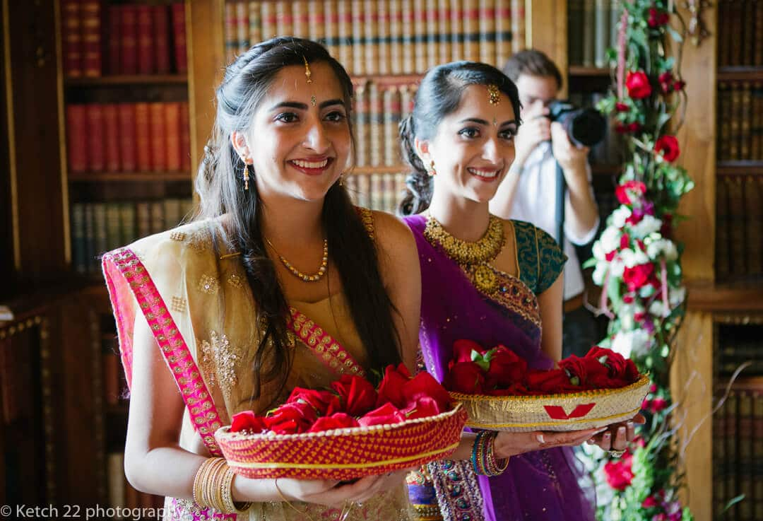 Bridesmaids with flowers at Indian wedding ceremony