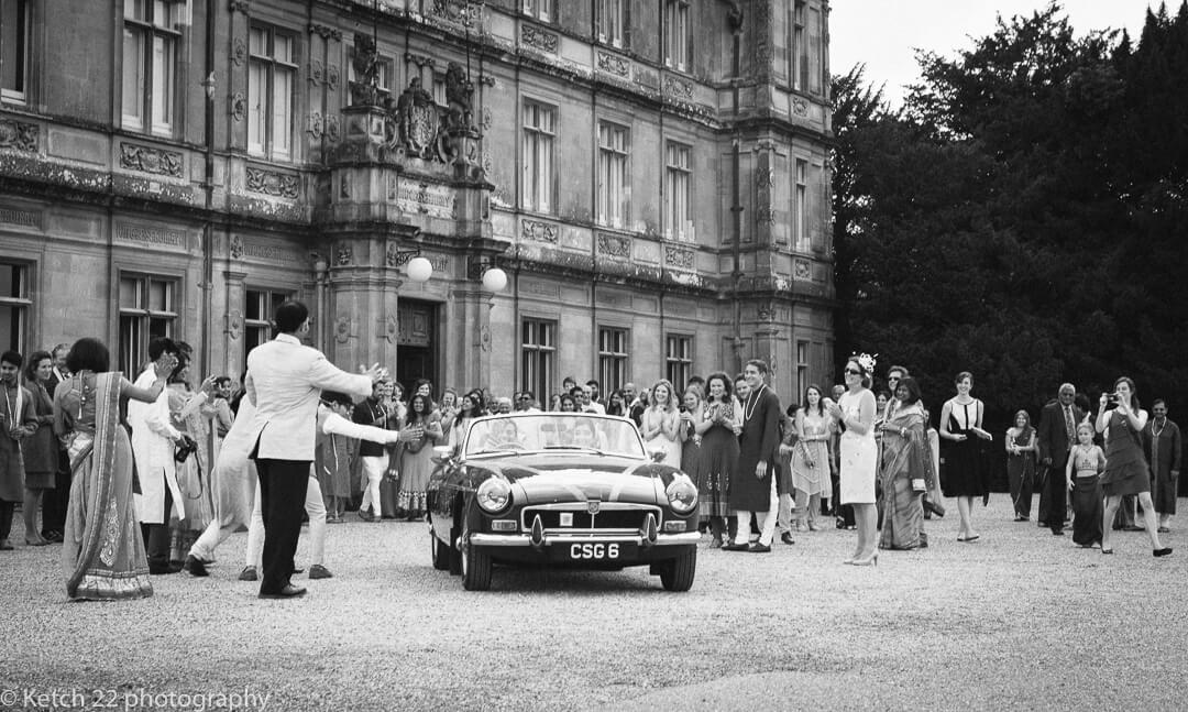 Wedding car leaving Highclere Castle