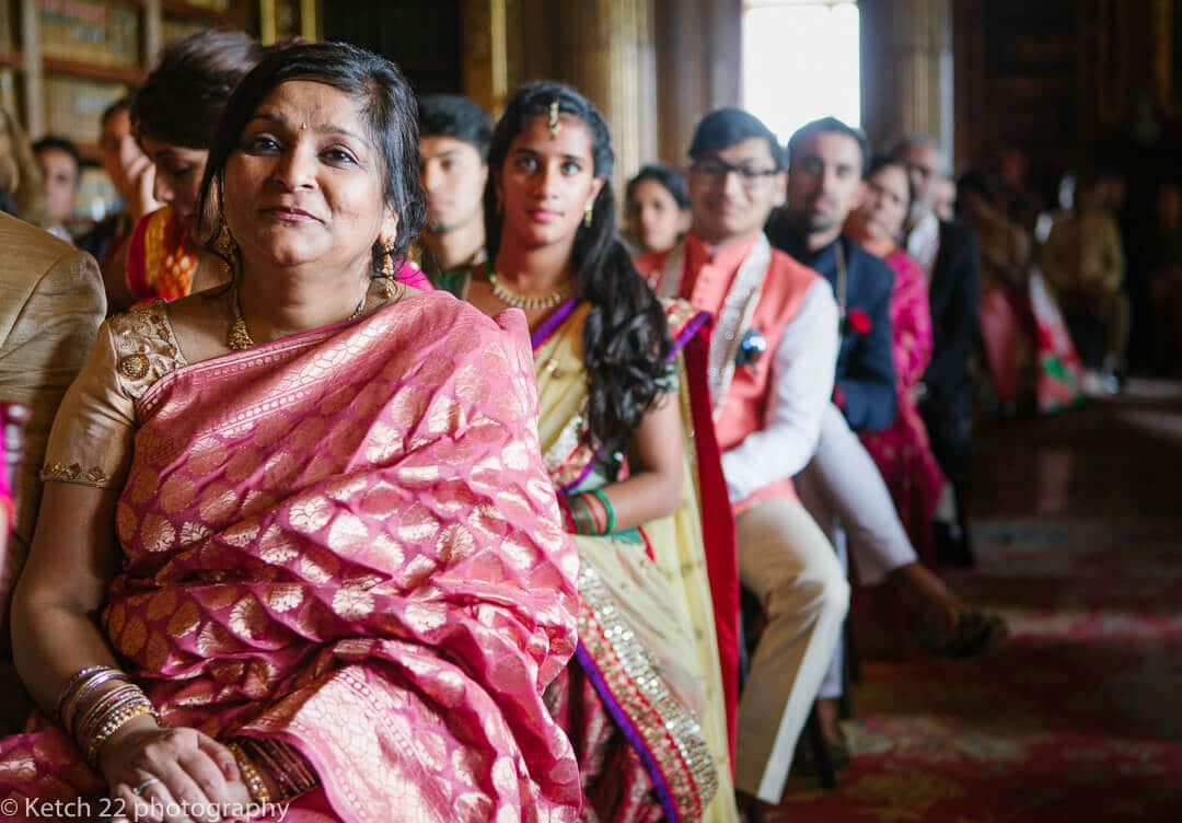Wedding guests watching Indian ceremony
