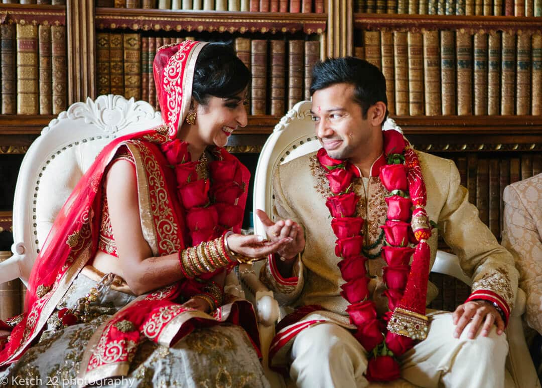 Bride and groom share flower petals at Indian wedding ceremony