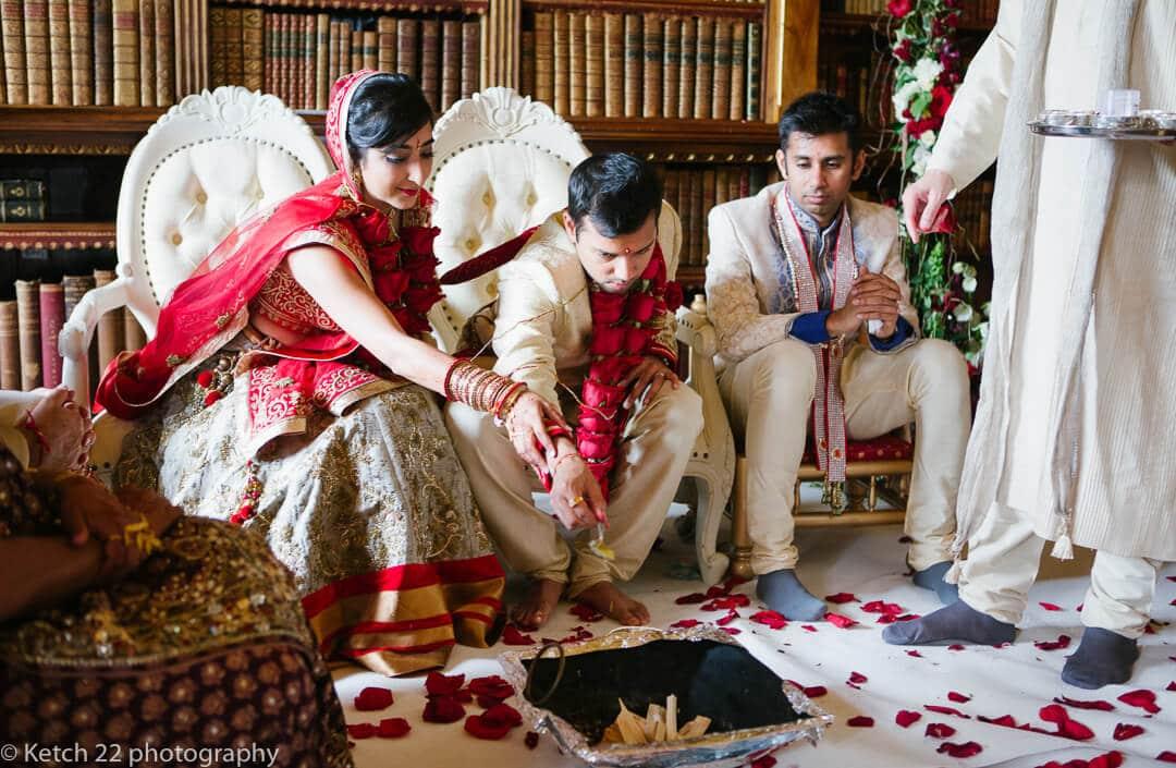 Bride and groom sprinkle dust on fire at Hindu wedding