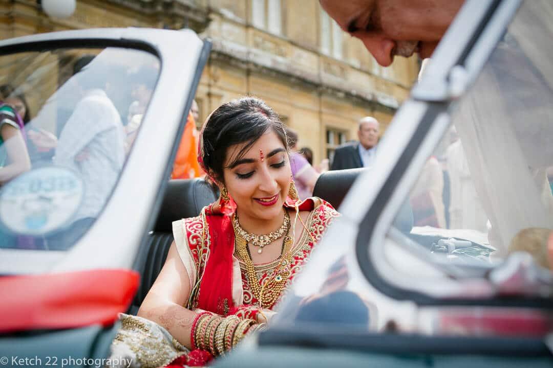 Hindu bride in wedding car