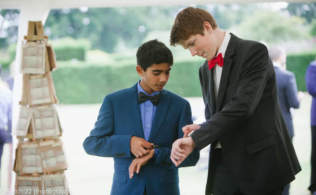 Wedding guests checking their watch's at reception