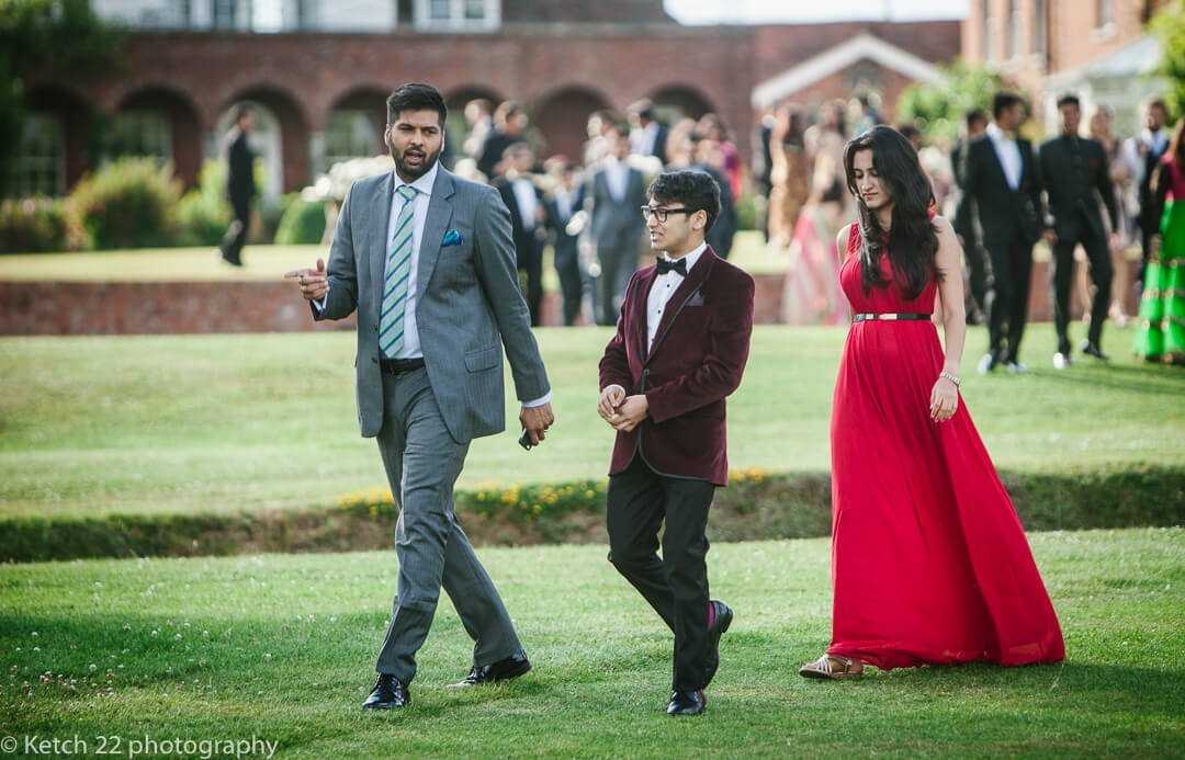 Wedding guests walking towards marquee