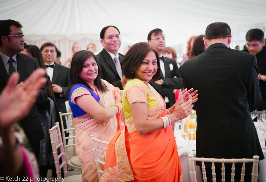 Indian wedding guests clapping