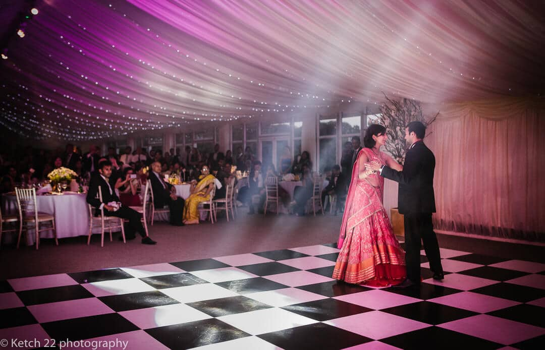 Bride and groom dancing at Hindu wedding