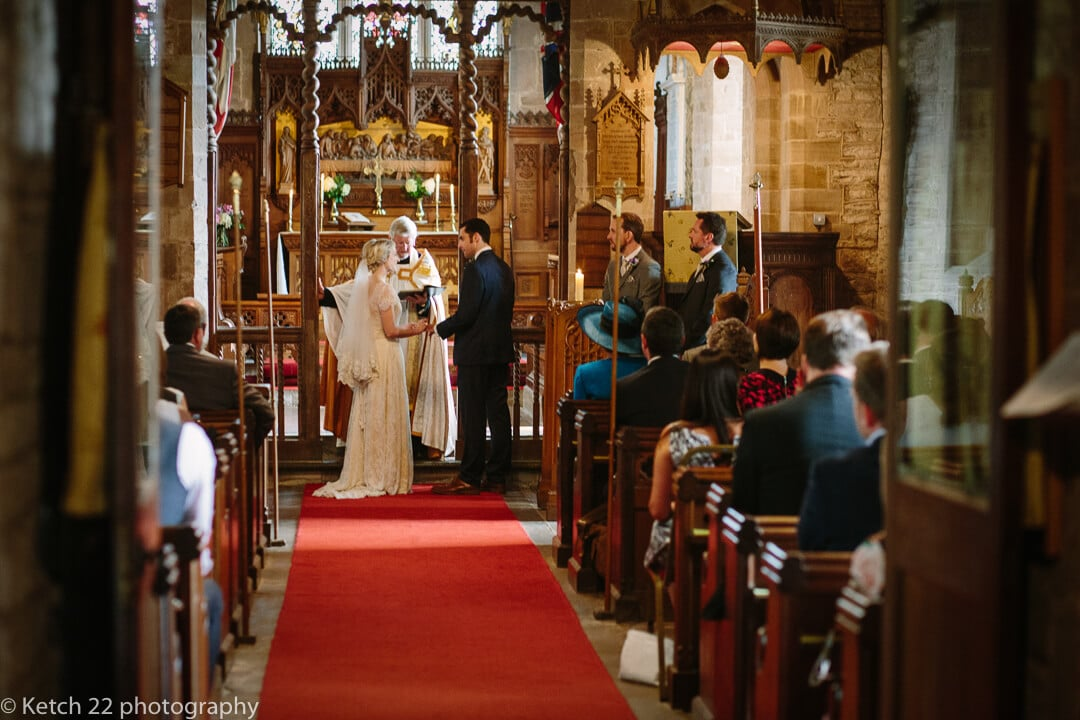 Bride and groom exchanging vows at How Caple church wedding