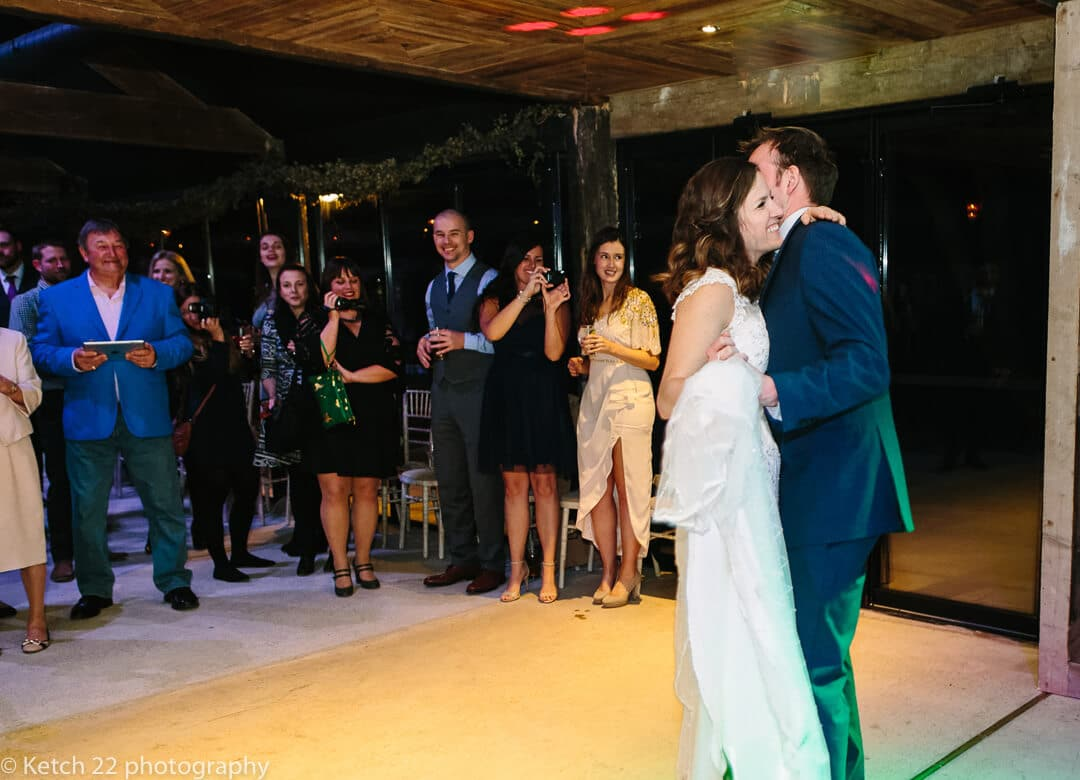 Bride and groom enjoying first dance at wedding reception