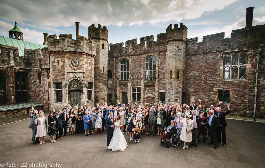 Photo of wedding party ai court yard at Berkeley Castle