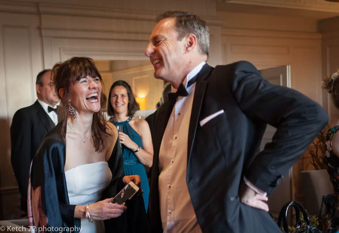 Wedding guests laughing at Foxhall Manor