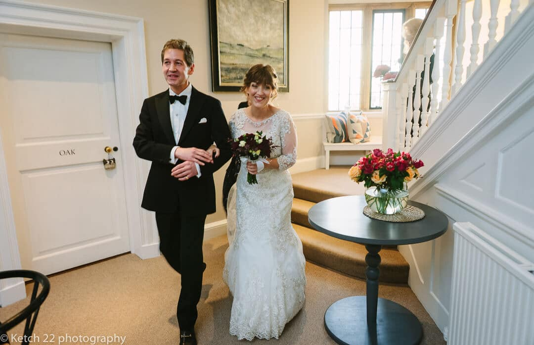 Bride walking through hallway at Cotswold Wedding