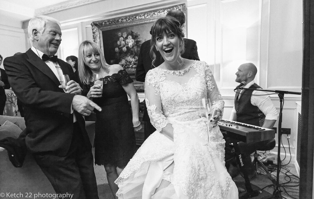 Funny photo of bride looking surprised at wedding