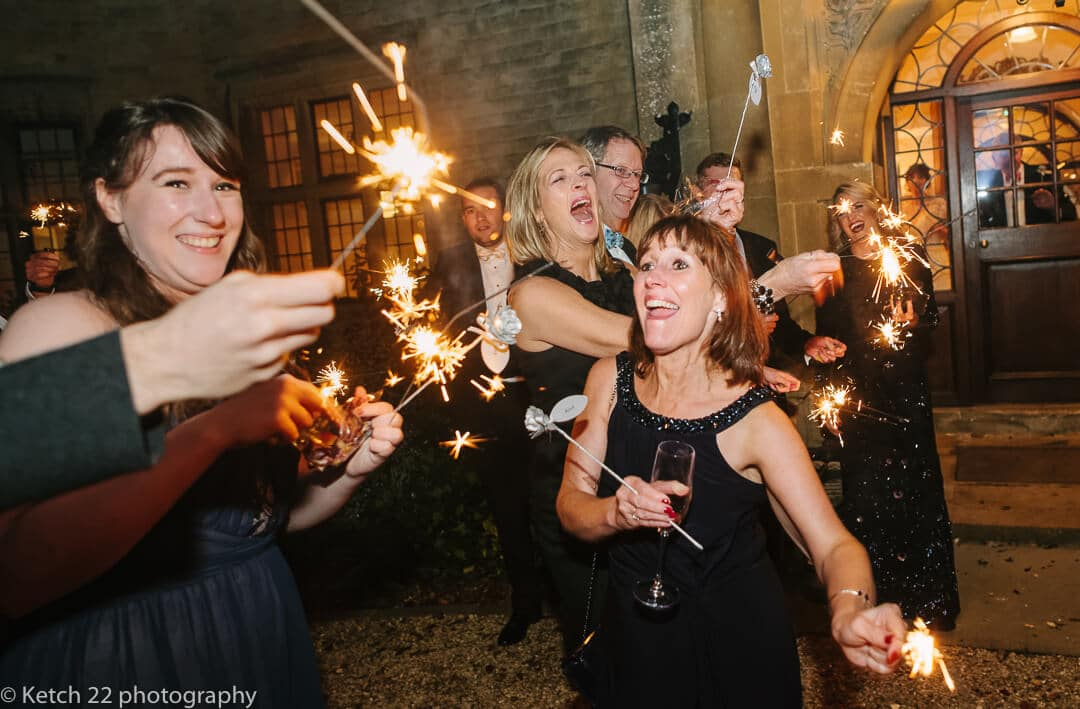 Wedding guests playing with sparklers
