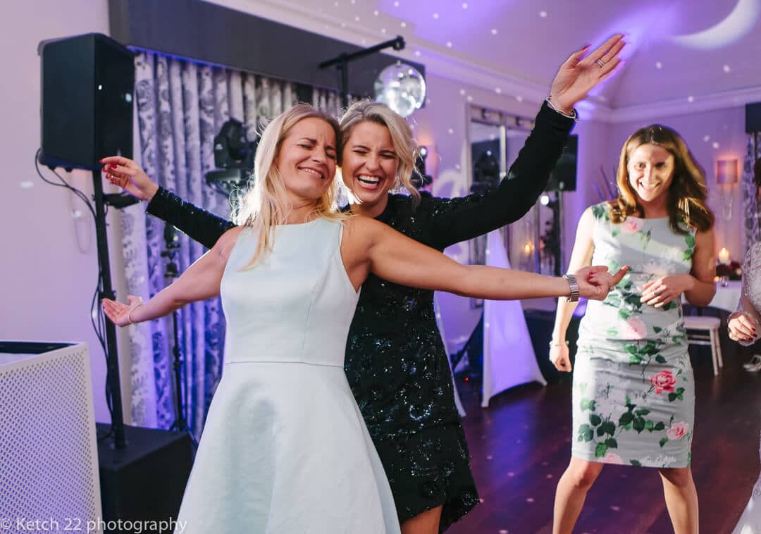 Two young women dancing at Foxhill manor wedding reception