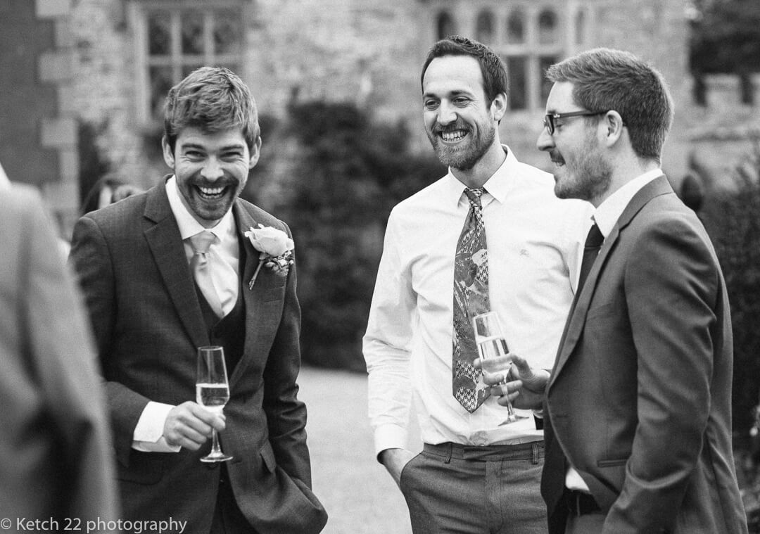 Groom and his friends relax, laugh and enjoy a drink