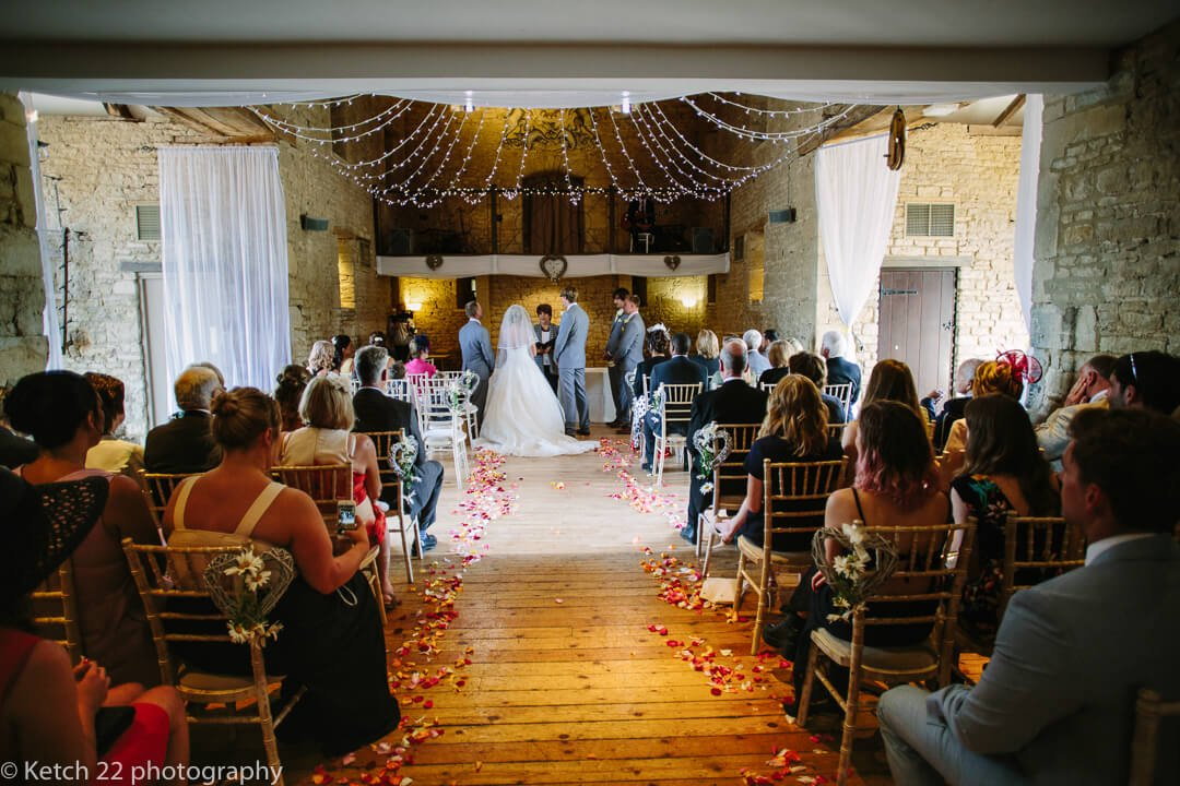 View of wedding ceremony at The Great Tythe Barn