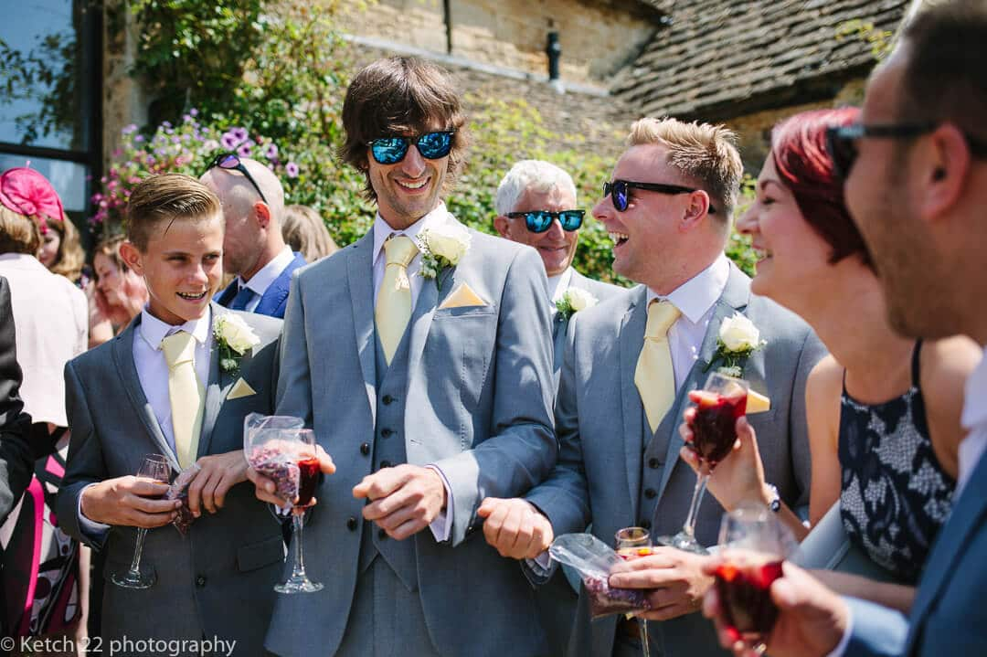 Wedding guests in blue suits laughing