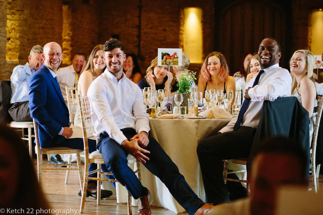 Wedding guests looking at Bride and groom in dinning room