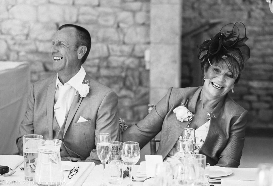 Mum and Dad laughing at wedding speeches