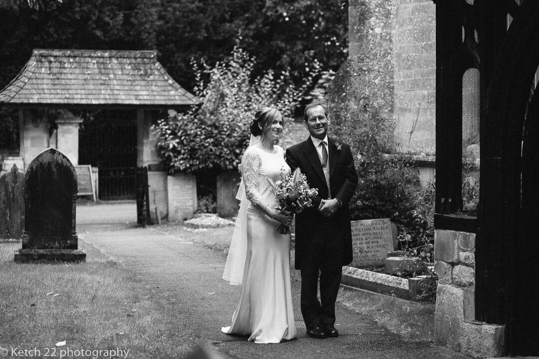 Father and bride waiting outside Church prior to wedding ceremomy