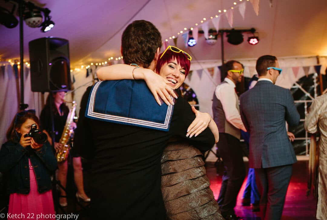Wedding guest dancing with her sailor boy friend