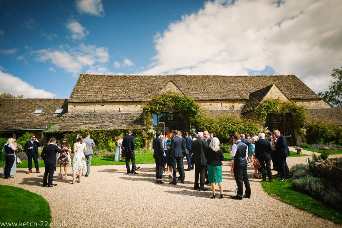 Guests waiting outside venue for Weddings at The Great Tythe Barn