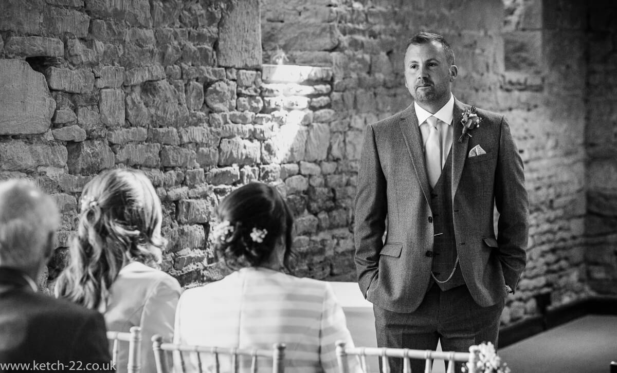 Groom looking anxious before wedding ceremony