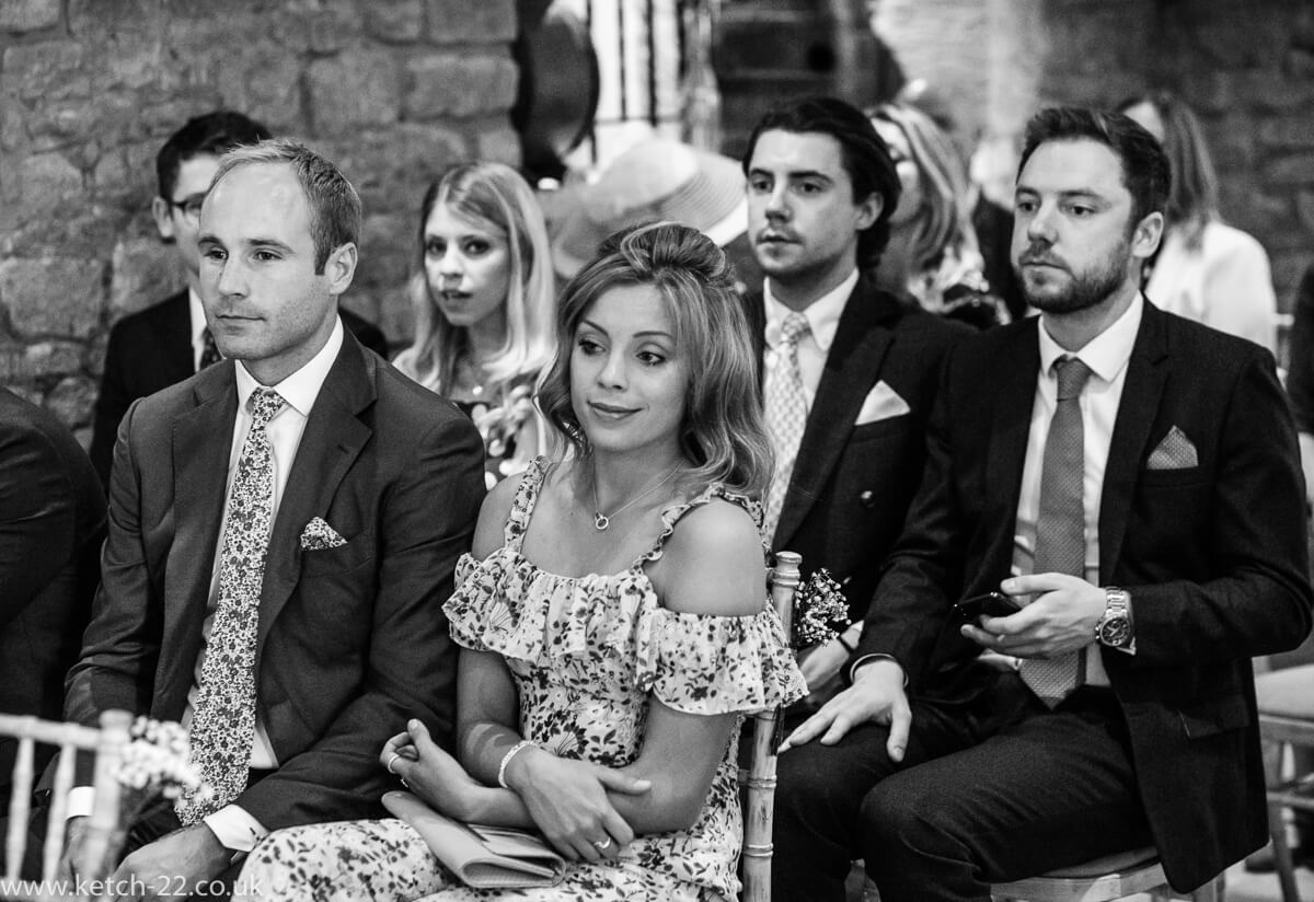 Wedding guests watching ceremony