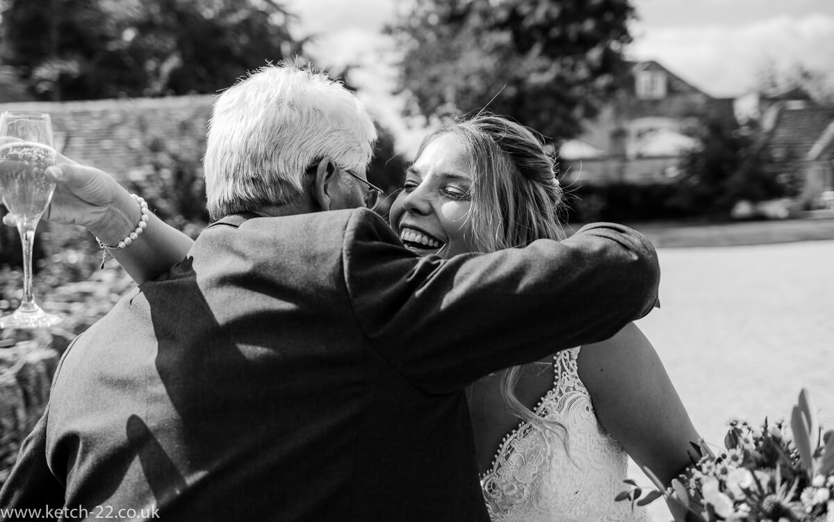 Father hugs his bride daughter at Wedding at The Great Tythe Barn