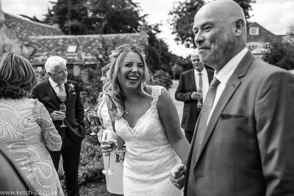 Bride relaxed and laughing at summer wedding