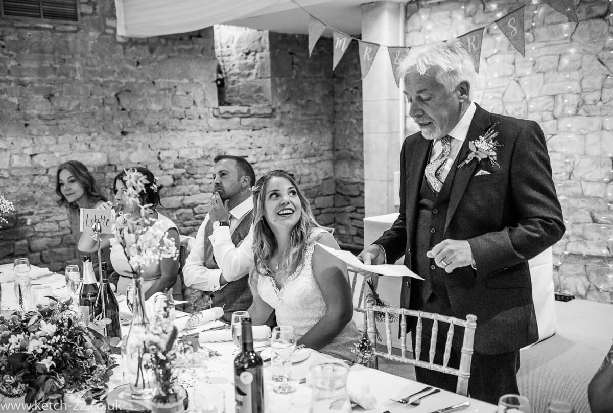 Father of bride making speech as daughter looks on