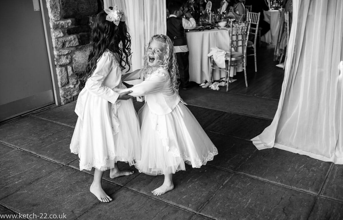 Flower girls playing at Wedding at The great tythe barn
