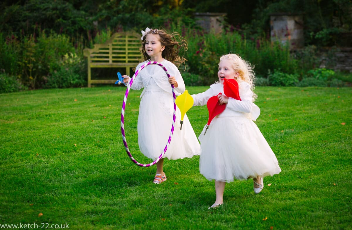 Flower girls with hoola hoops