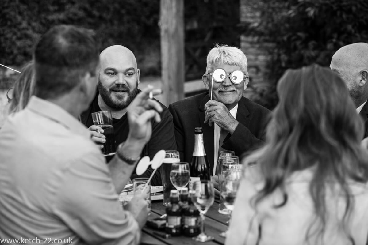 Wedding guest wearing comic eyes at the Great Tythe Barn