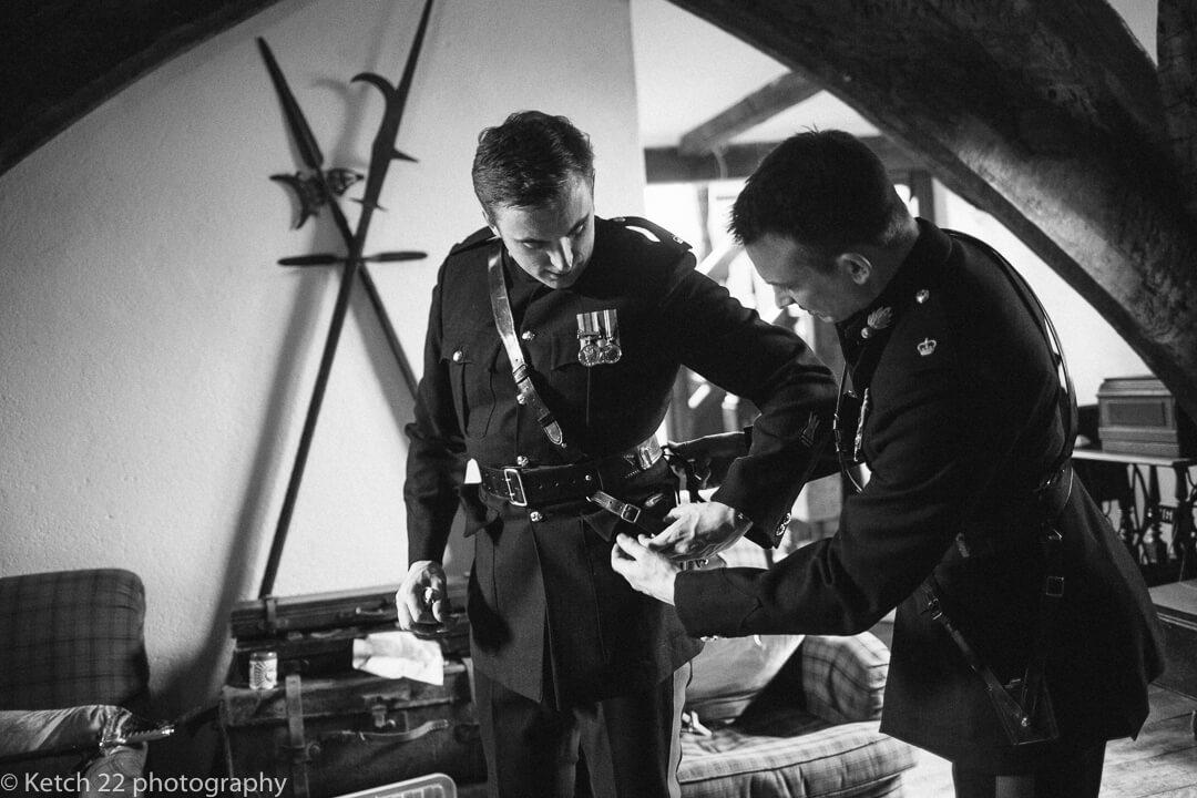 Groomsmen in army uniform getting ready