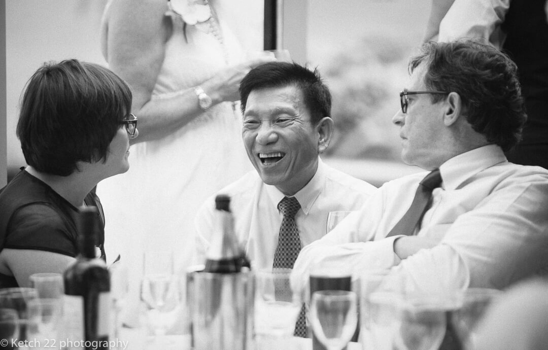 Chinese wedding guest laughing