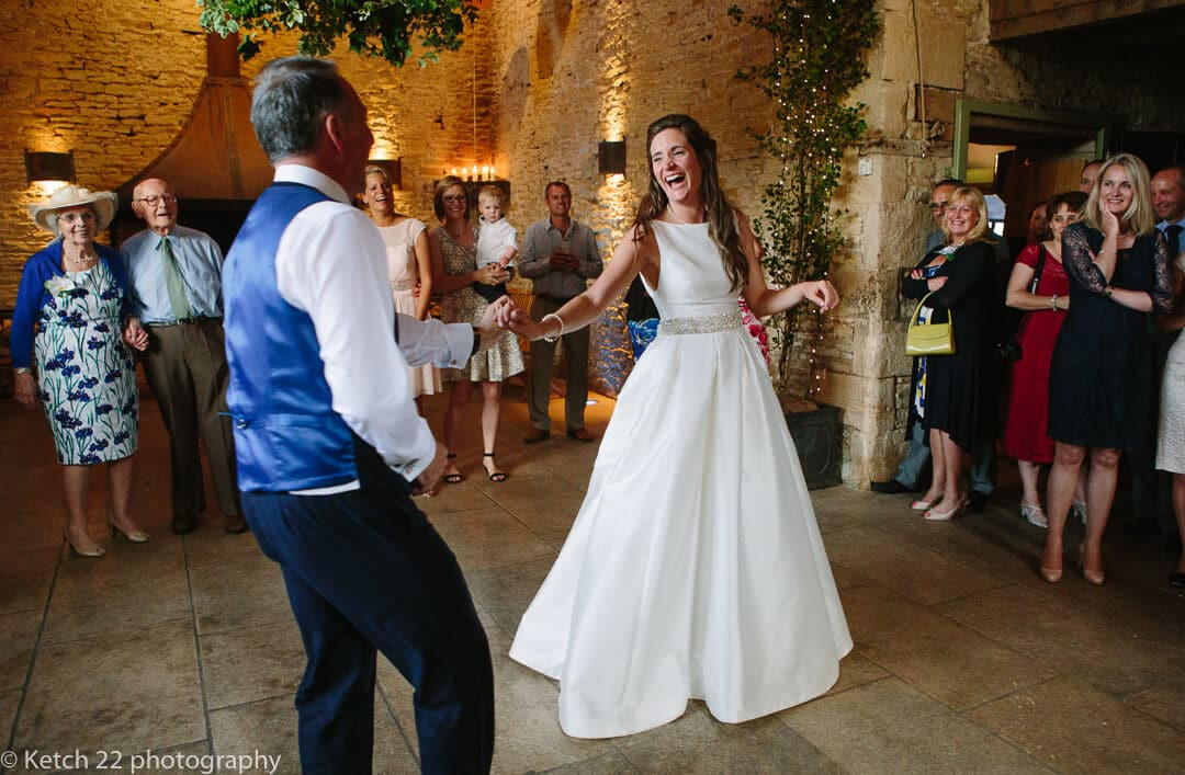 Bride and groom enjoying first dance at Cripps Stone Barn
