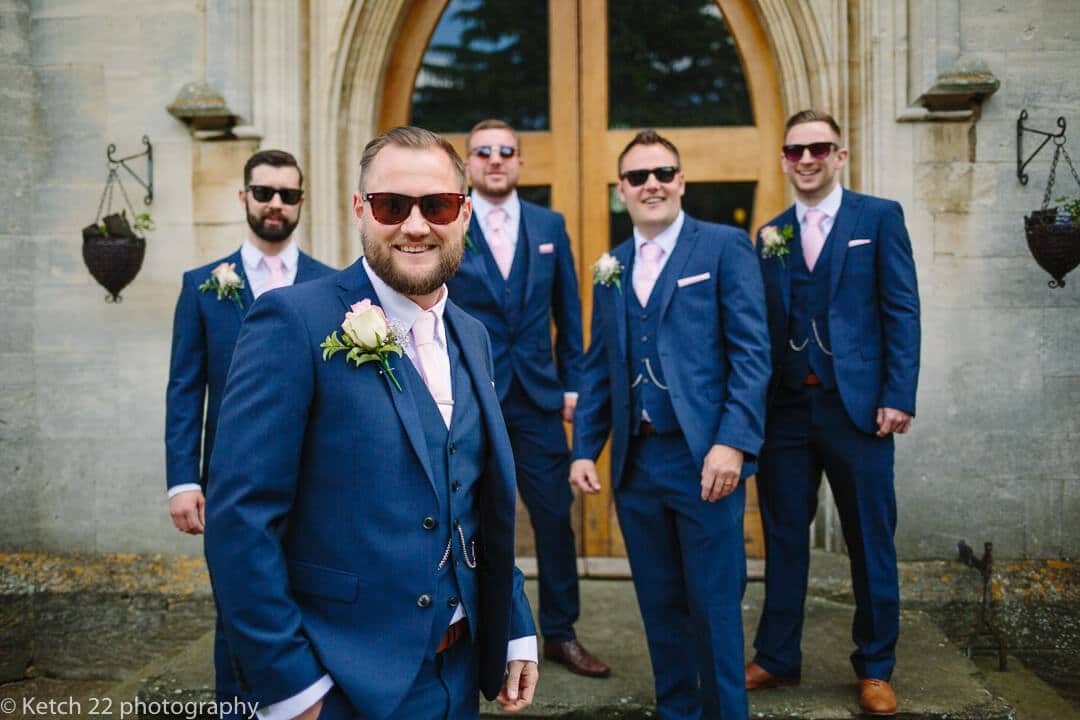 Groom and groomsmen with shades and blue suits at Gloucestershire wedding