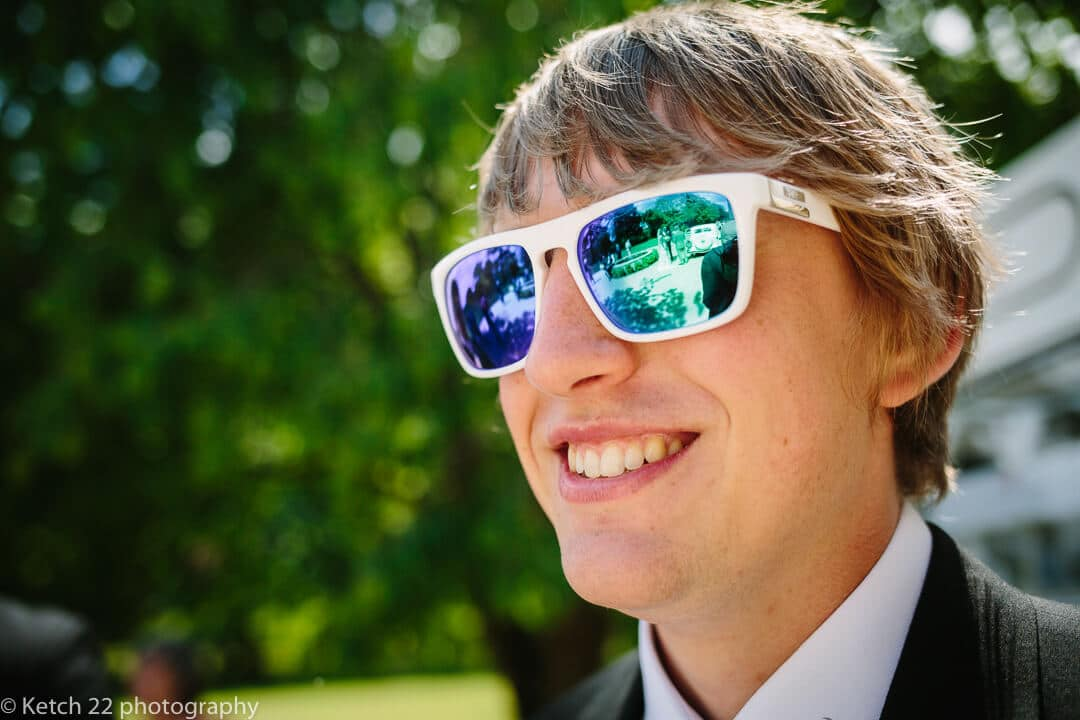 Wedding guest with blue reflective sunglasses